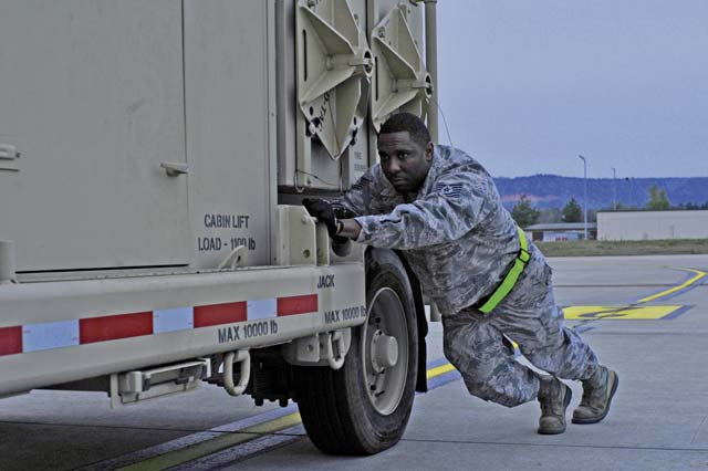 1st Combat Communications Squadron Airmen assist loadmasters