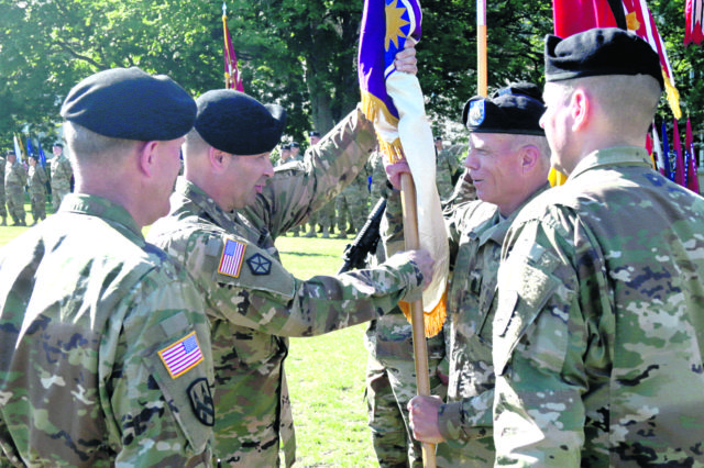 Seven years later, Heston returns to 361st Civil Affairs Brigade as new commander