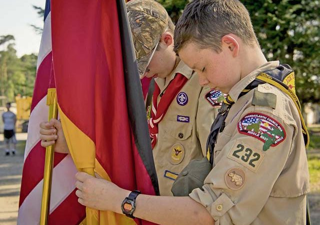 Children of Ramstein personnel who are members of the Boy Scouts of America bow their heads in respect during the invocation at a Flag Day flag disposal ceremony June 14 on Ramstein.