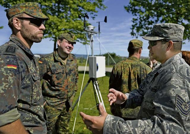 Tech. Sgt. Christopher Hardy, 7th Weather Squadron noncommissioned officer in charge of regional weather maintenance, right, speaks with German NATO partners during a weather-related exercise June 12 in Wiesbaden. The 7 WS uses Exercise Cadre Focus to enhance its capability to provide weather support to U.S. Army operations in Europe.
