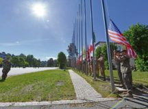 U.S. and NATO military members raise their countries' flags during the opening ceremony for exercise Saber Strike 17 June 3 at Adazi Military Base, Latvia. 11,000 U.S. and NATO military members from 20 countries participated in the exercise from May 28 to June 24 throughout the Baltics and Poland. Saber Strike 17 promotes regional stability and security, while strengthening partner capabilities and fostering trust.