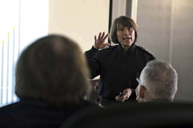 'Vice Adm. Raquel C. Bono, Defense Health Agency director, gives a presentation to base members during a visit to Ramstein, Aug. 22. Bono discussed upcoming changes to the health care program for Tricare beneficiaries.' from the web at 'http://www.kaiserslauternamerican.com/wp-content/uploads/2017/08/P1b-3.jpg'