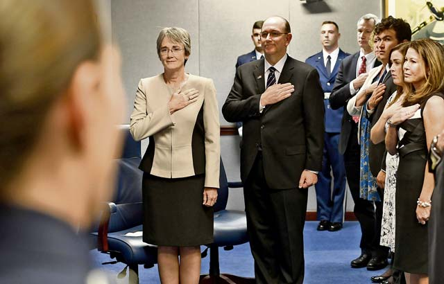 Secretary of the Air Force Heather Wilson and to-be sworn in Undersecretary of the Air Force Matthew Donovan stand during the National Anthem Aug. 11 at his swearing-in ceremony at the Pentagon in Arlington County, Va.