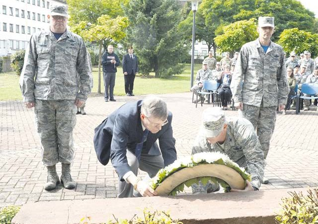 Retired Air Force Col. Kenneth Cordier, a former Vietnam prisoner of war (1966 to 1973), and Col. Matthew Villella, 435th Air Expeditionary Wing and 435th Air Ground Operations Wing vice commander, place the POW/MIA memorial wreath Sept. 15 on Ramstein's River Rats memorial. According to the Defense POW/MIA Accounting Agency, there are no more than 82,000 military members unaccounted for from past conflicts, 1,600 from Vietnam alone.