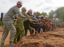 Military and civilian officials participate in a groundbreaking ceremony for a school building Sept. 29 at Vogelweh. The U.S. Department of Defense Education Activity is pushing an initiative to establish more student-centered and energy efficient schools.
