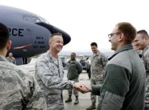 Col. Clifton Reed, 6th Maintenance Group commander, coins an Airman from the 86th Maintenance Squadron Oct. 2 on Ramstein Air Base. Reed paid a visit to Ramstein to personally thank 86th MXS Airmen that helped repair a KC-135 Stratotanker from MacDill Air Force Base, Fla.