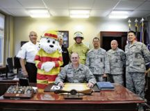 """Brig. Gen. Richard G. Moore, Jr., 86th Airlift Wing commander, and leadership from the 86th Civil Engineer Group and 86th Civil Engineer Squadron gather for the signing of the Kaiserslautern Military Community's Fire Prevention Proclamation Sept. 28 at Ramstein. This year's Fire Prevention Week theme, """"Every second counts, plan two ways out!"""", is to encourage people to have more than one safe exit during a fire incident. — Photo by Airman 1st Class Savannah L. Waters"""
