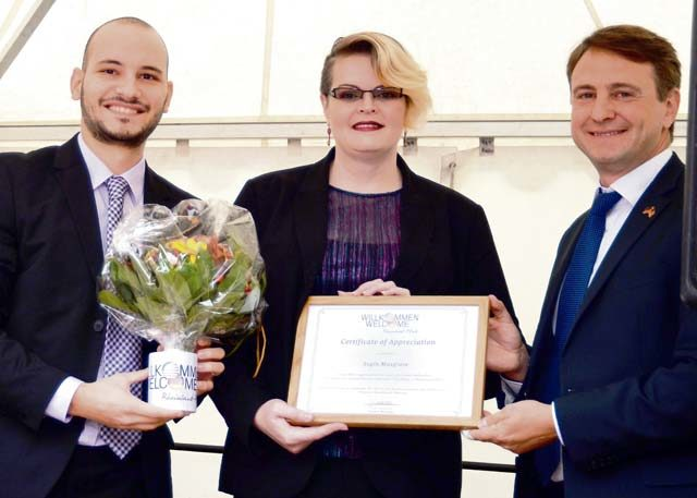 KMC spouse strengthens community ties; honored for German-American contributions