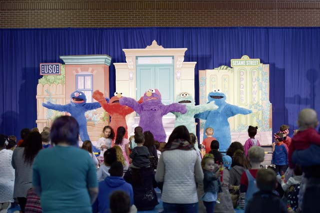 Sesame Street characters sing a song to the audience at the USO's Sesame Street Tour Oct. 5 on Ramstein Air Base. The show consisted of a medley of songs and dances, teaching military children how to adjust to frequent changes in their lives.