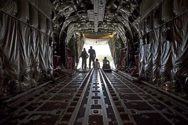 Airmen assigned to the 86th Aircraft Maintenance Squadron and 37th Airlift Squadron sit in a C-130J Super Hercules during taxi to a parking spot Oct. 13 on Ramstein Air Base. Crew chiefs work hand in hand with pilots to ensure all issues that arise with the aircraft are resolved.
