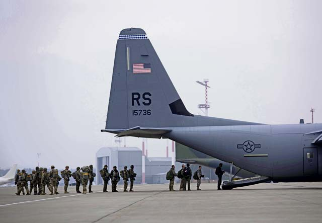 Paratroopers with the U.S. Air Force, U.S. Army, and German Air Force prepare to board a U.S. Air Force C-130J Super Hercules Dec. 6 on Ramstein Air Base. The paratroopers participated in Operation Toy Drop 2017 to maintain their military free fall and jump master proficiencies. — Photo by Senior Airman Devin M. Rumbaugh