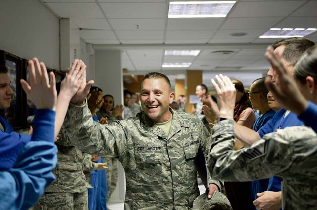 Senior Master Sgt. Daniel Stellabotte, 86th Dental Squadron dental operations superintendent, receives congratulations from his colleagues after being selected for promotion to the rank of chief master sergeant. Chief master sergeant corresponds with the pay grade E-9, and is the highest enlisted rank an Airman can attain.