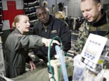 Senior Airman Shelby Lucas, 10th Expeditionary Aeromedical Evacuation flight critical care transport team respiratory therapist, explains the role of a critical care air transport team to Partnership Flight Symposium participants Jan. 17 on Ramstein Air Base. The CCATT's mission is unique, as it's staffed to operate an intensive care unit in an aircraft during flight. — Photo by Tech. Sgt. Rachelle Coleman