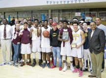 Led by head coach DeWayne Piggé (far left) and assistant Darrell Winfrey (far right) the Buccaneers earned the school's first boys' basketball title since 2009.