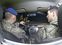 Marcus Mueller, left, 86th Security Forces Squadron patrolman, drives a patrol vehicle with U.S. Air Force Airman 1st Class Daniel Regan, 86th SFS member, Feb. 26 on Ramstein Air Base. Zivilpolizei, or Civilian Security Police, are the civilian side of the 86th SFS, and they bring a wealth of experience to Ramstein's law enforcement.