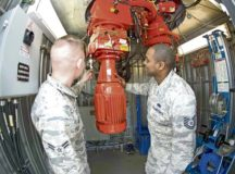 Airman 1st Class Connor Murph, left, 86th Operations Support Squadron Air Traffic Control and Landing Systems radar, airfield, and weather systems technician, and Tech. Sgt. Jerel Sledge, RAWS production control noncommissioned officer in charge, observe the primary engine which turns the radar dish at the digital airport surveillance radar tower March 14 on Ramstein Air Base. No matter the weather, day and night, the 86th OSS ATCALS team ensures that when pilots need guidance on and off the flightline, the systems in place are ready.