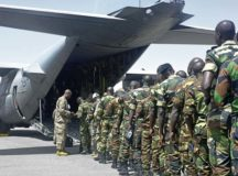 Participants of African Partnership Flight Senegal prepare to board a C-130H Hercules assigned to the 130th Airlift Wing, West Viginia Air National Guard, March 22 at Captain Andalla Cisse Air Base, Senegal. The APF program is U.S. Air Forces Africa's premier security cooperation program with African partner nations to improve professional military aviation knowledge and skills.