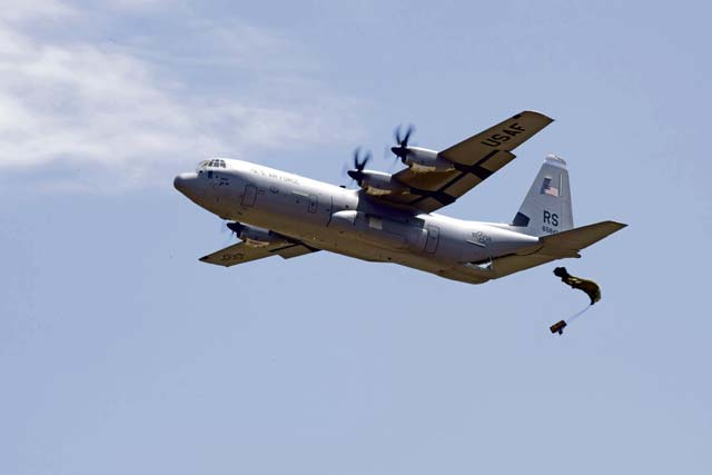 A U.S. Air Force C-130J Super Hercules drops an equipment bundle during exercise Stolen Cerberus V May 15 over Megara Drop Zone, Greece. Hellenic riggers worked with U.S. Air Force Joint Airdrop Inspectors to ensure the bundle was rigged properly.