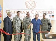 Brig. Gen. Richard G. Moore Jr., 86th Airlift Wing commander, and Andreas Klein, German Canteen concessionaire, cut a ribbon, reopening the German Canteen May 22 on Ramstein Air Base. Since the German Canteen's original opening in 1954 and moving to its current location more than 40 years ago, the German Canteen has served the Kaiserslautern Military Community authentic traditional cuisine.