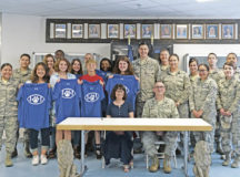 Ramstein High School students, staff, and 86th Communications Squadron service members pose for a group photo after signing an Adopt-a-School Partnership Memorandum of Understanding May 31 on Ramstein Air Base. The Adopt-a-School program is a voluntary, ongoing partnership between a school and a military unit to foster a mutually beneficial partnership between the students and the Airmen and Soldiers of the Kaiserslautern Military Community.