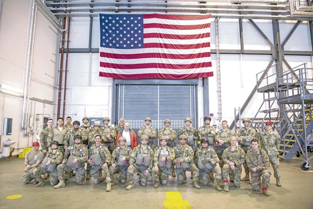 Members of the 435th Contingency Response Group pose for a photo with the Honorable F. Whitten Peters, 19th Secretary of the Air Force (center), prior to boarding a C-130J Super Hercules aircraft to conduct static-line jumps over Ramstein Air Base, March 8. Peters served as the SECAF when the first CRG was created in 1999.