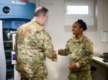 U.S Air Force Tech. Sgt. Déja Kiziah, 86th Medical Squadron non commissioned officer in charge of shipping, is recognized as Airlifter of the Week by Brig. Gen. Mark R. August, 86th Airlift Wing commander, and Command Chief Master Sgt. Ernesto Rendon, 86th Airlift Wing command chief, at the Armed Services Blood Bank Center for Europe on Landstuhl, April 11. Kiziah was recognized for supporting exercise African Lion, a multinational joint and combined exercise conducted in the Kingdom of Morocco, while continuing to supply routine customers throughout Europe, the Middle East and Africa with lifesaving blood products.
