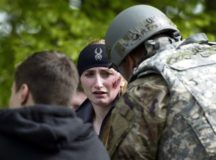 A simulated traffic accident victim speaks to a U.S. Air Force Chaplain during Exercise Operation Varsity 19-02 on Ramstein Air Base, May 10. The 86th Airlift Wing Chaplain Corps supported injured members before they were transported to medical treatment facilities.