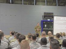 .S. Air Force Brig. Gen. Mark R. August, 86th Airlift Wing commander, speaks to a group of Airmen at an all-call on Ramstein Air Base, April 26. During the all-call August outlined his future goals for the wing.
