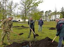U.S. Air Force Brig. Gen. Mark R. August, 86th Airlift Wing commander, shovels dirt with members of the German forest authority, during an Earth Day tree planting ceremony on Ramstein Air Base, April 29. The tree planting symbolized support for environmental protection as well as a continued joint partnership between the 86th AW and Germany's environmental authorities.