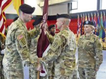 Brig. Gen. Ron Stephens, Regional Health Command Europe commanding general and U.S. Army Europe Command Surgeon, passes the colors to Col. Brian Spangler, new Public Health Command Europe commander, during the PHCE change of command ceremony.