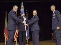U.S. Air Force Col. Beth Graboritz, 65th Air Base Group commander, receives a guidon from U.S. Air Force Brig. Gen. Mark R. August, 86th Airlift Wing commander, during a change of command ceremony at Lajes Field, Azores, Portugal, on Aug. 22. Graboritz accepted her new position in front of 65th ABG Airmen and host nation personnel.