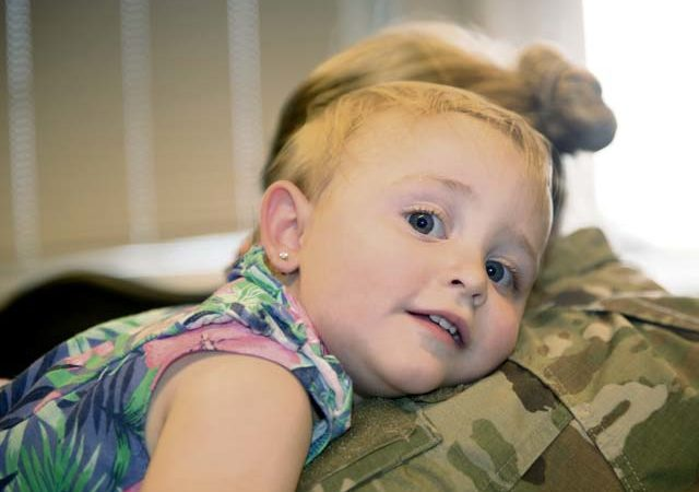 A child shares a hug with her mother at Ramstein Air Base, Aug. 9. To provide more options for parents, the Key and Essential Family Child Care Provider Initiative was created as part of a Kaiserslautern Military Community-wide effort to support military families.
