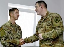 """U.S. Air Force Senior Airman Scott """"Scotty"""" Plante, 86th Logistics Readiness Squadron preventative maintenance technician, shakes hands with Brig. Gen. Mark R. August, 86th Airlift Wing commander, on Ramstein Air Base, July 26. Plante received the honor of being Airlifter of the Week for his fuel support of Air Force One, eliminating 20 workplace hazards and enabling 100 percent tracking of all trucks going in and out of service."""