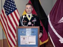 U.S. Army Sgt. 1st Class Jared Smith, an infantryman assigned as a platoon sergeant with the Medical Transient Detachment, Landstuhl Regional Medical Center, displays his awards and medal as a new inductee into the National Infantry Association's Order of Saint Maurice. The special honor is awarded to those who have significantly contributed to the infantry and stand out in the eyes of the their senior leaders, subordinates and peers.