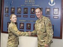 U.S. Air Force Col. Matt S. Husemann, 86th Airlift Wing vice commander, poses for a photo with Senior Airman April VanHorn, 86th Aerospace Medical Squadron medical technician, to recognize her as Airlifter of the Week at Ramstein Air Base, Oct. 11. VanHorn received the award after streamlining several processes prior to a group inspection and for her proactiveness in providing first response action to an unconscious individual during a trip to Oktoberfest.