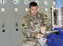 Col. Jason Edwards, U.S. Army Garrison Rheinland-Pfalz commander, takes a water sample at the Pfeffelbach Water Treatment Plant near Baumholder. The Pfeffelbach plant provides water to the Baumholder Military Community. Photo by Bernd Mai