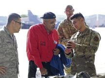Vincent Boles, retired Army veteran, talks with Airmen from the 86th Logistical Readiness Squadron during Retiree Appreciation Day at Ramstein Air Base Oct. 22. Airmen had the chance to show retired service members gear that the Air Force uses in their day-to-day missions.