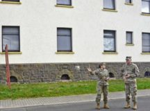 Sgt. 1st Class Mirna Velez De Mansilla, Baumholder Army Health Clinic detachment sergeant, shows U.S. Army Garrison Rheinland-Pfalz Command Sgt. Maj. Brett Waterhouse the lack of available parking space at the barracks housing Soldiers from the Health, Dental and Veterinary Clinics on Smith Barracks. Velez De Mansilla brought up the concern at the quarterly Army Barracks Management Program meeting for the Baumholder Military Community Oct. 25.