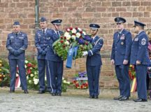 U.S. Air Force Brig. Gen. Mark R. August, 86th Airlift Wing commander, and U.S. Air Force Chief Master Sgt. Ernesto J. Rendon, 86th AW command chief, look on as members of the Ramstein Air Base Honor Guard prepare to lay a wreath during the Ramstein-Miesenbach National Day of Mourning Ceremony, Nov. 17. The National Day of Mourning is a German holiday where citizens mourn victims of war. The ceremony included NATO armed forces members, local officials and members of the Kaiserslautern community. Photo by Airman 1st Class Taylor D. Slater
