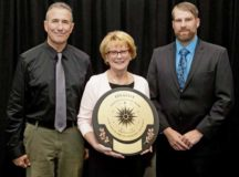 Three U.S. Army Garrison Rheinland-Pfalz Directorate of Family, Morale, Welfare and Recreation employees, (from left) Steve Selvey, Kaiserslautern Outdoor Recreation director; Ingrid Osewalt, Kaiserslautern DFMWR deputy director and Beau Yeager, Baumholder Outdoor Recreation director; accept the award for being a finalist in the Armed Forces category in the 2019 National Recreation and Park Association National Gold Medal Award program in Baltimore, Maryland, in September.