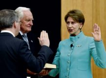 David L. Norquist, deputy secretary of defense, left, administers the oath of office for Secretary of the Air Force Barbara M. Barrett during her ceremonial swearing-in at the U.S. Air Force Academy, Colorado Springs, Colo., Nov. 2. Barrett will be responsible for organizing, training and equipping 685,000 active-duty, Guard, Reserve and civilian Airmen, as well as managing a 205 billion dollar budget. Holding the Bible to her right is her husband of 34 years, Dr. Craig R. Barrett. Photos by Wayne Clark