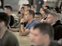 Airmen assigned to the 521st Air Mobility Operations Wing listen to guest speakers Capt. John Arroyo and Dr. Dave Roever, Sept. 15 at Ramstein Air Base.