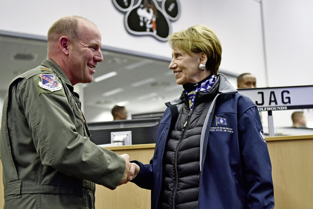 U.S. Air Force Maj. Kevin Edwards, U.S. Air Forces in Europe and Air Forces Africa joint interface control officer, receives a coin from Secretary of the Air Force Barbara Barrett during a tour of the 603rd Air and Space Operations Center at Ramstein Air Base, Nov. 22. Photo by Master Sgt. Renae Pittman