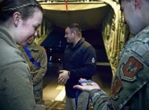 U.S. Air Force 2nd Lt. Lydia Byrom, left, 86th Aeromedical Evacuation Squadron readiness officer in charge, and Senior Airman Terry Kularski, 86th Aircraft Maintenance Squadron hydraulic system specialist, look at a Medal of Honor at Ramstein Air Base, Jan. 13. The medal was awarded to retired U.S. Army Master Sgt. Leroy Petry for his actions in Afghanistan in 2008. Operation Proper Exit and the Troops First Foundation brought Petry and several other wounded warriors to Ramstein to visit the 86th AES, the squadron that medically evacuated them from Iraq and Afghanistan to Landstuhl Regional Medical Center.