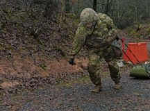 1st Lt. Jeffery Jerschina, medical-surgical nurse with the 212th Combat Support Hospital transports a simulated casualty while testing for the Expert Field Medical Badge at Baumholder, Dec. 16, 2019. The 421st Multifunctional Medical Battalion hosted the training and testing from Dec. 2-19. The EFMB is one of the most difficult and prestigious Army special skill badges to earn with a fiscal passing rate below 20%.
