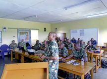 An Airman from the Malawian air force briefs members of the U.S. Air Forces in Europe and Air Forces Africa Manpower, Personnel and Services Directorate, Force Development team at Lilongwe Air Base, Malawi, Jan. 14. The USAFE-AFAFRICA force development team has been working with the Malawian air force since 2018 to build partnership capacity in the region.