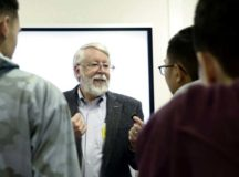 Jay Simpson, former Technical Director and Program Manager for the CIA, meets with students for hands-on activities during an educational event hosted by the Air Force Association and Kaiserslautern High School Science, Technology, Engineering and Mathematics program at Kapaun Air Station, Dec. 16, 2019. Simpson wrote several books on optical fiber technology and is responsible for 80 publications and 15 patents in the field.