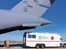 An ambulance bus backs up to the Mississippi Air National Guard C-17 Globemaster III as Airmen prepare to unload patients at Joint Base Andrews, Maryland, April 26, 2018. The bus transports the ill and/or injured to Walter Reed National Military Medical Center in Bethesda, Maryland. JBA and Travis Air Force Base, California, serve as the primary military entry points or hubs for patient distribution within the Continental United States. Photo by Karina Luis
