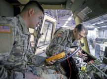 U.S. Army Spc. Stiven Rosales and U.S. Army Master Sgt. Ryan Thiers, both wheeled vehicle mechanics assigned to 21st Theater Sustainment Command, troubleshoot an Army cargo truck at the Daenner Kaserne Motor pool Dec. 18, 2019 in Kaiserslautern. The assigned mechanics are responsible for maintaining vehicle mobility by troubleshooting, fixing and maintaining roughly 60 vehicles at the motor pool.