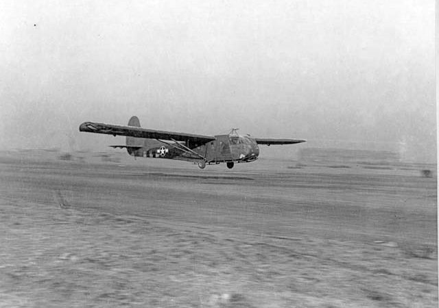 """The CG-4A was the primary combat glider for the United States Army Air Forces in World War II and one of two types of combat gliders used by the 435th Troop Carrier Group. Approximately 280 glider pilots formed the 435th Glider Combat Team, trained extensively on infantry weapons and tactics, and fought a key defensive action against a German counter-attack in a night fight nicknamed the """"Battle of Burp Gun Corner.""""  Photo courtesy of National Archives and Records Administration, College Park, Maryland"""